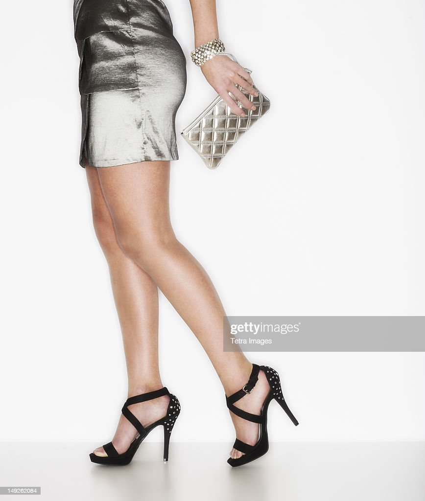 Studio shot of woman wearing mini dress and stilettos : Stock Photo