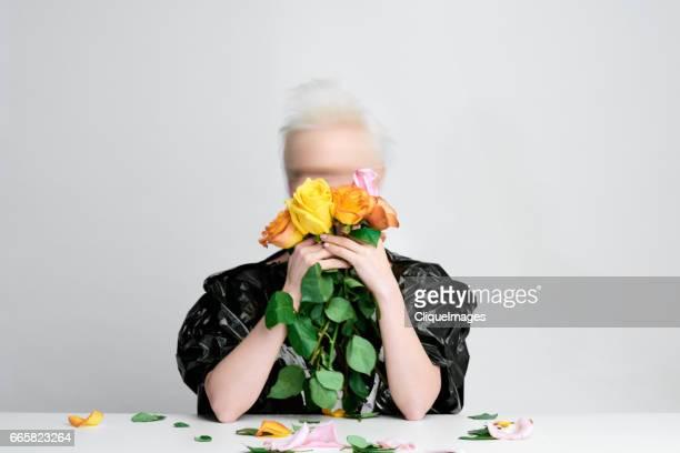 studio shot of woman with roses - cliqueimages ストックフォトと画像