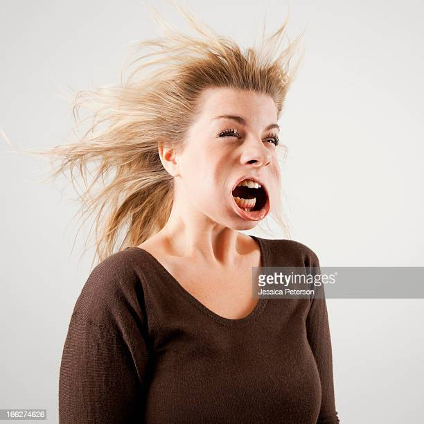 studio shot of woman with windblown mouth - ugly people stock-fotos und bilder