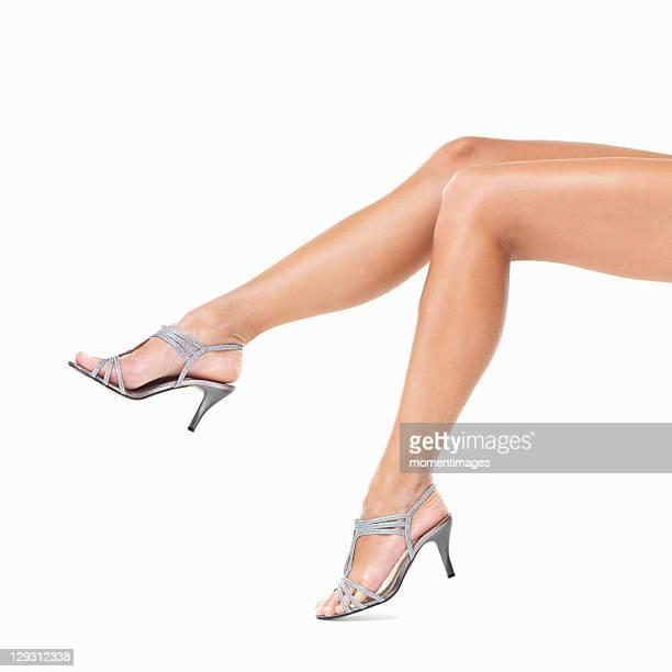 Studio shot of woman's legs wearing sexy sandals