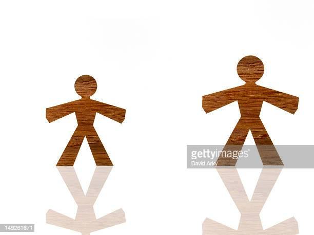 Studio shot of wood grain stick figures