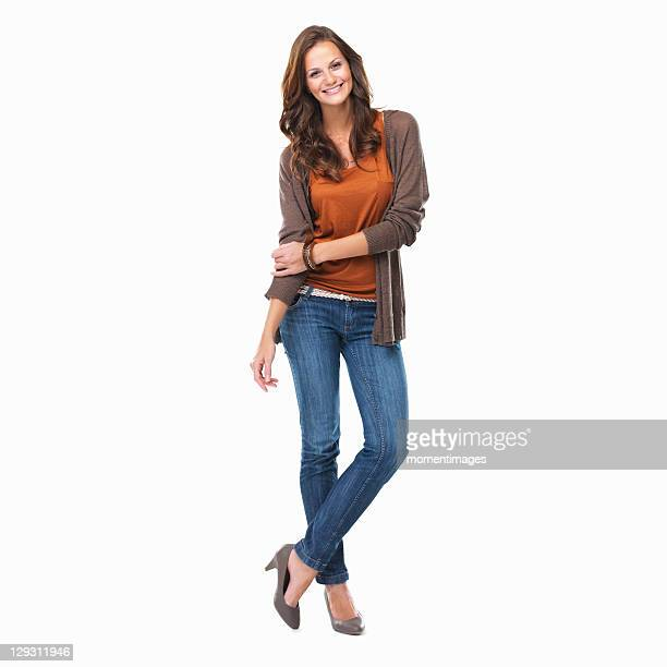 studio shot of young attractive woman standing on white background and smiling - legs crossed at ankle stock pictures, royalty-free photos & images