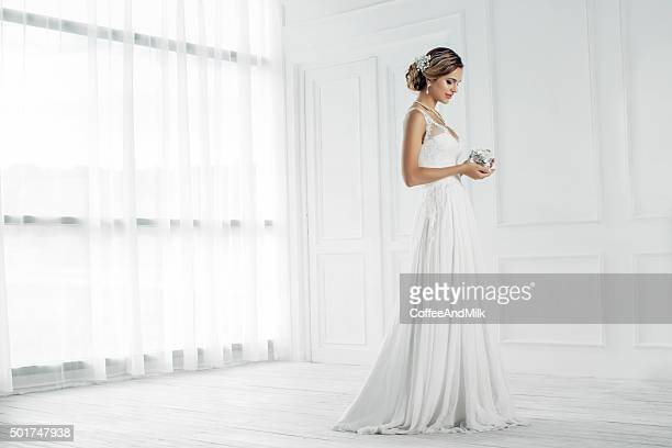 studio shot of young beautiful bride - bride stock photos and pictures