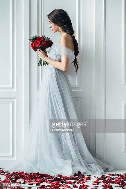 studio shot of young beautiful bride - red roses stock pictures, royalty-free photos & images
