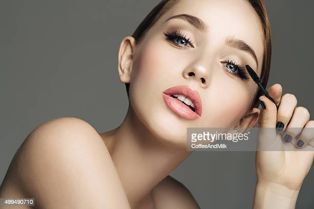 studio shot of young beautiful girl - eye make up stock photos and pictures