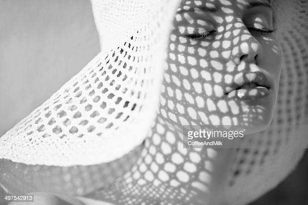 Studio shot of young beautiful woman in retro style
