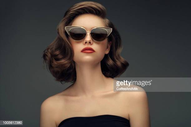 studio shot of young beautiful woman - fashion stock pictures, royalty-free photos & images