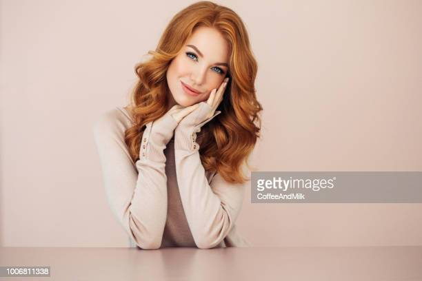 studio shot of young beautiful woman - redhead stock pictures, royalty-free photos & images