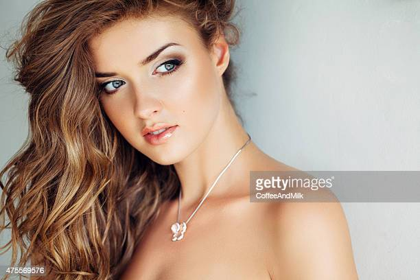 studio shot of young beautiful woman - necklace stock pictures, royalty-free photos & images
