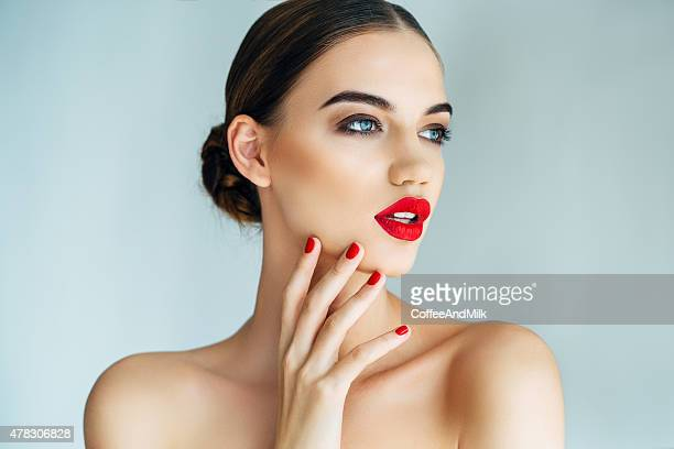 studio shot of young beautiful woman - lipstick stock pictures, royalty-free photos & images