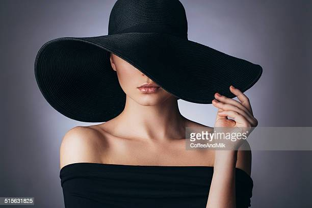 studio shot of young beautiful woman - hat stock photos and pictures
