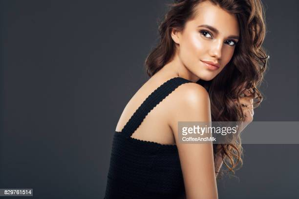 studio shot of young beautiful woman - brown hair stock pictures, royalty-free photos & images