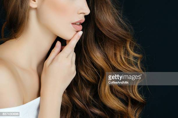 studio shot of young beautiful woman - long hair stock pictures, royalty-free photos & images