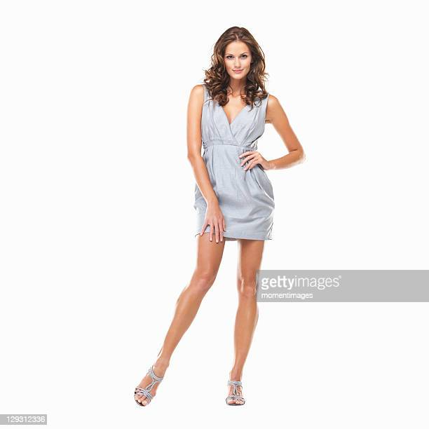 Studio shot of young beautiful woman standing on white background