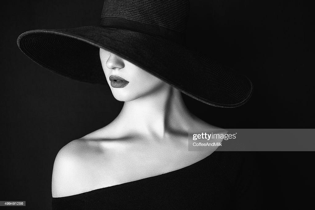 Studio shot of young beautiful woman wearing hat : Stock Photo