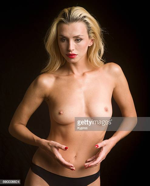 Studio Shot Of Young Caucasian Woman Topless