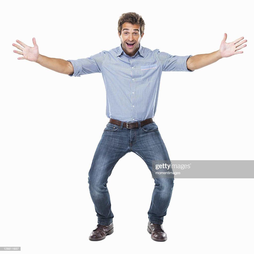 Studio shot of young cheerful man with arms outstretched : Stock-Foto