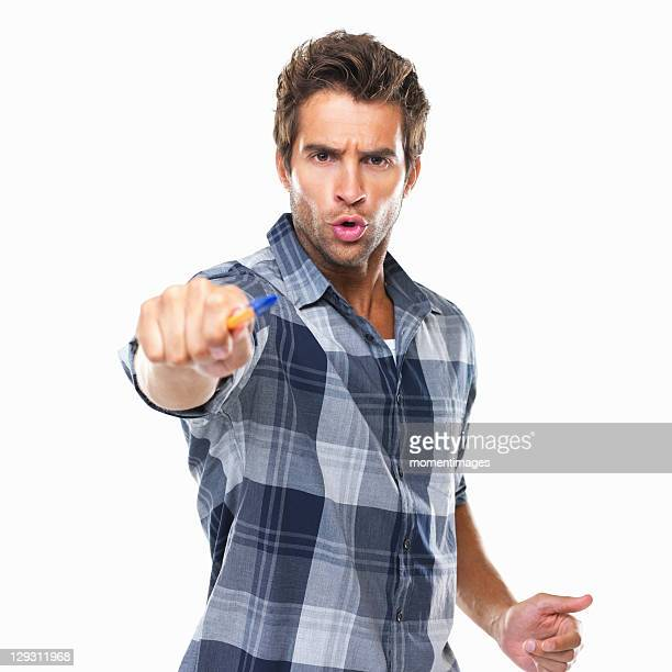 studio shot of young confident man pointing with pen at camera - aggression stock photos and pictures