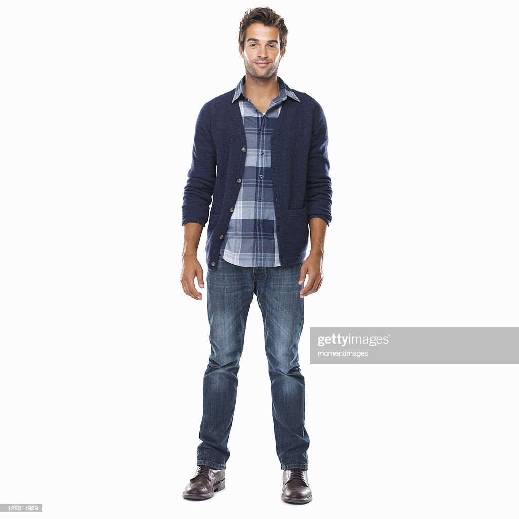 Studio shot of young confident man standing on white background and smiling : Foto stock