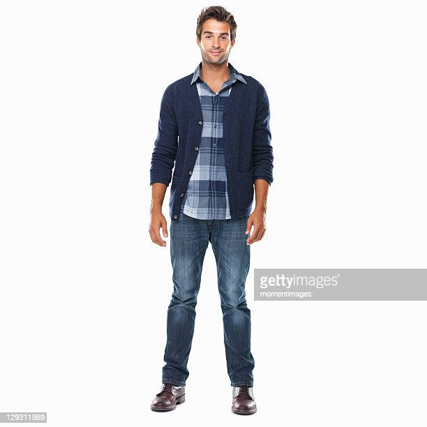 studio shot of young confident man standing on white background and smiling - stare in piedi foto e immagini stock