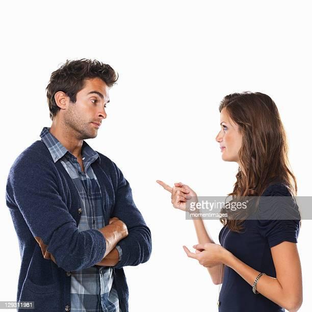 Studio shot of young couple having argument