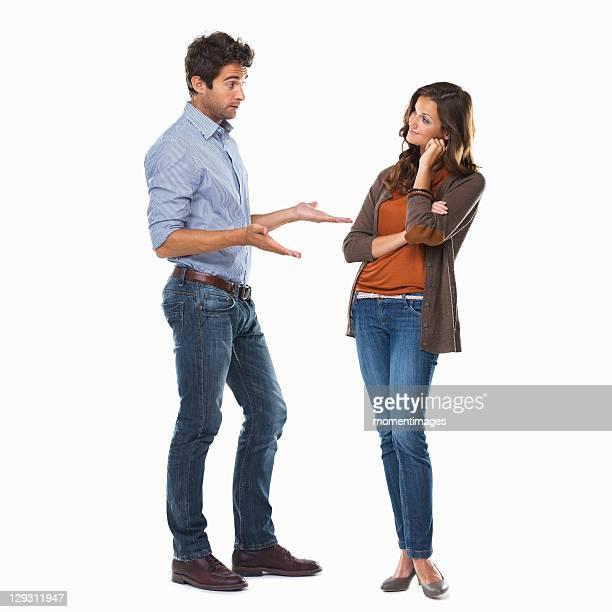 Studio shot of young couple having conversation