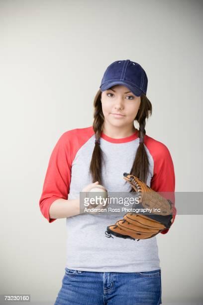 studio shot of young hispanic woman with baseball glove - キャッチャーミット ストックフォトと画像