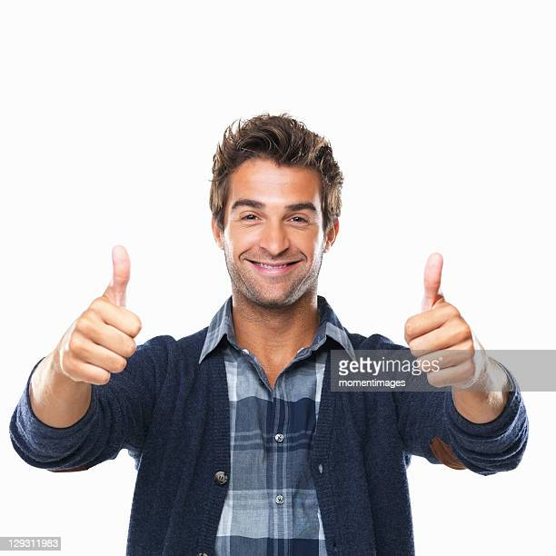 Studio shot of young man with two thumbs up