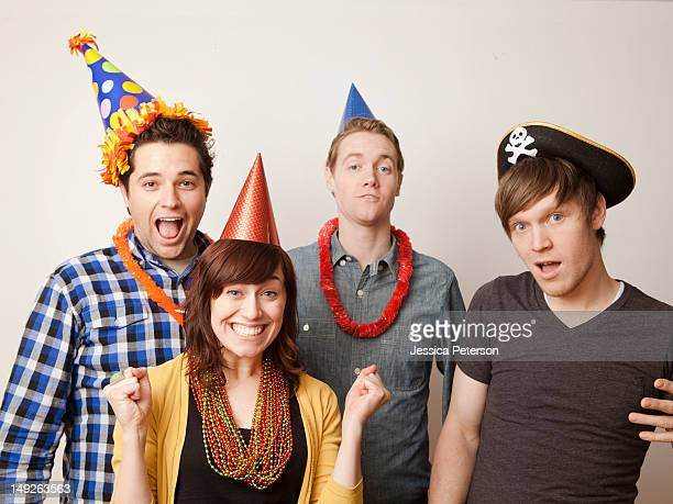 Studio Shot of young people dressed up in party hat