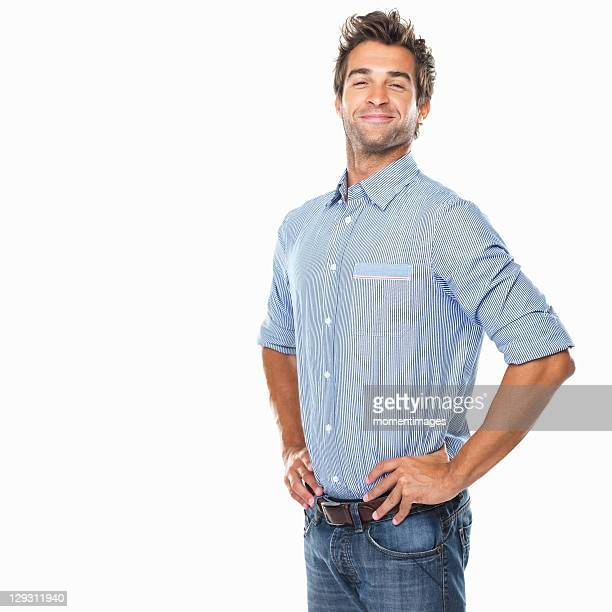 studio shot of young pride man with hands on hips - orgoglio foto e immagini stock