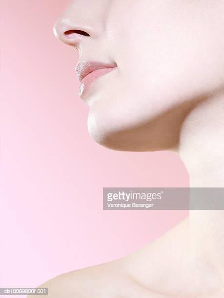 studio shot of young woman, close-up of neck and chin - anatomie stock pictures, royalty-free photos & images
