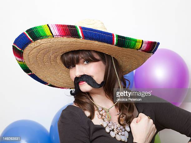 studio shot of young woman dressed up as mexican - mexican hat stock pictures, royalty-free photos & images