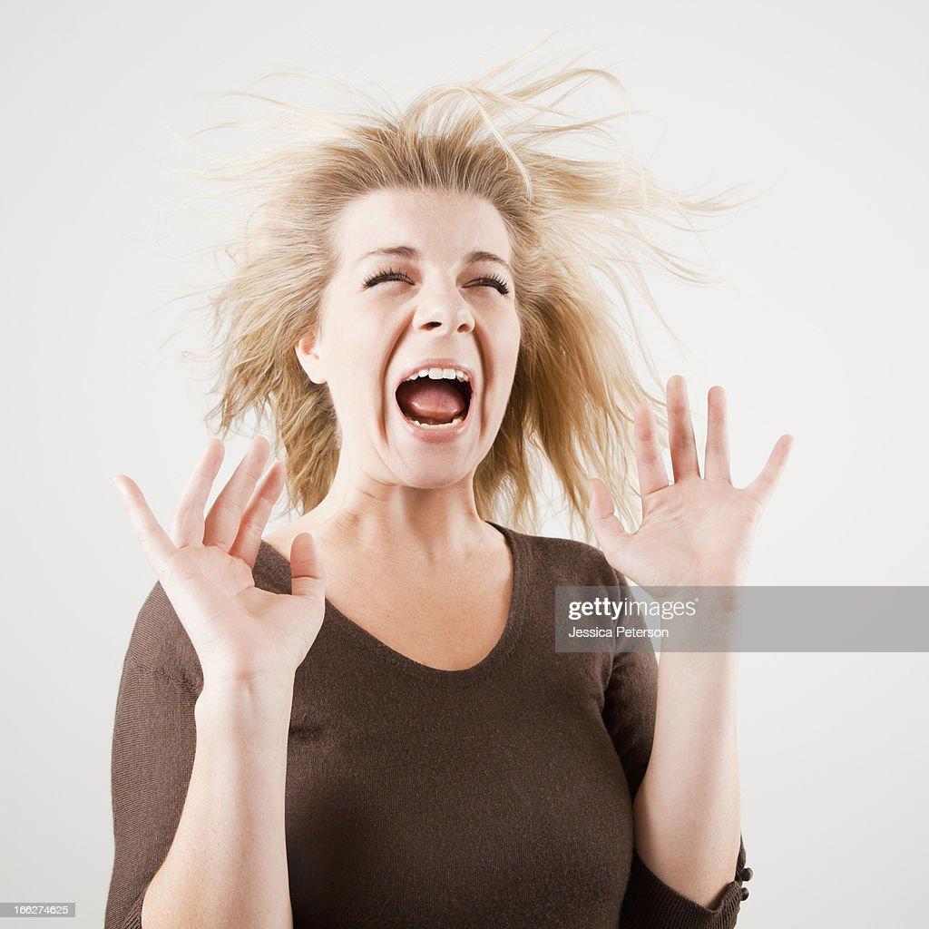 Studio shot of young woman screaming : Stock Photo