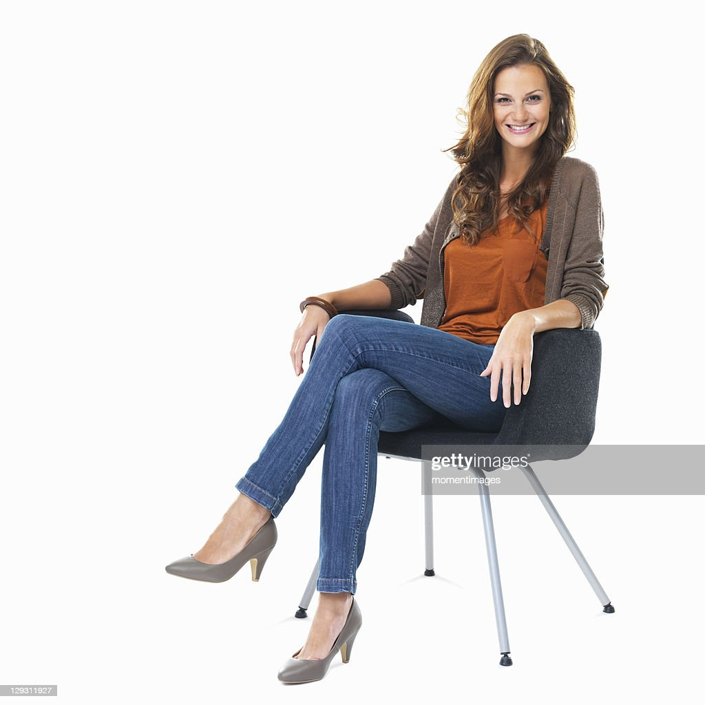 Studio Shot Of Young Woman Sitting In Chair Stock Photo