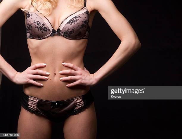 studio shot of young woman wearing bra - knickers fotografías e imágenes de stock
