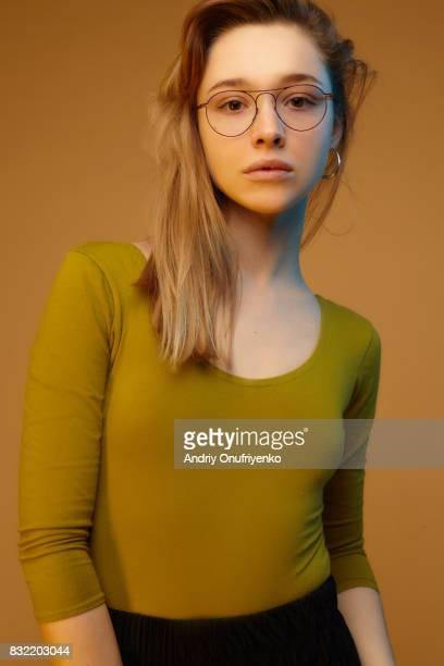 Studio shot of young woman wearing glasses
