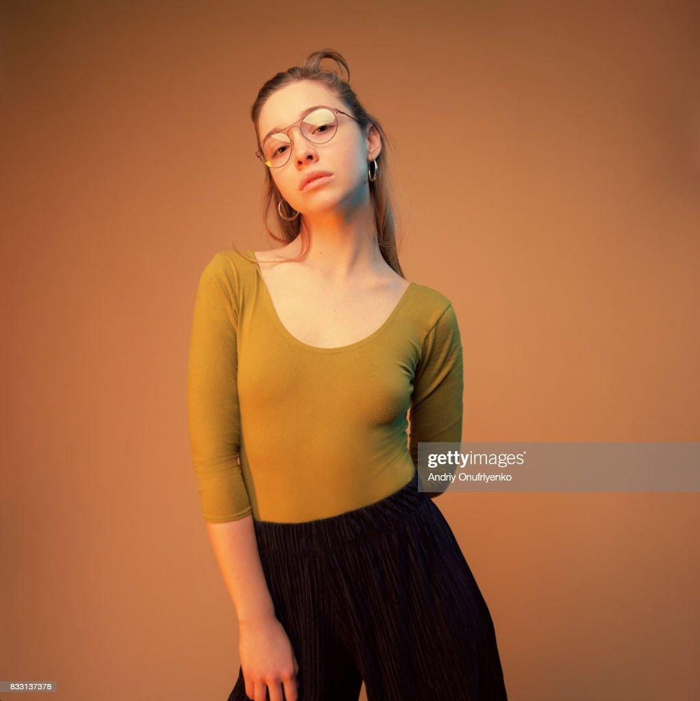 Studio shot of young woman wearing glasses : Stock Photo