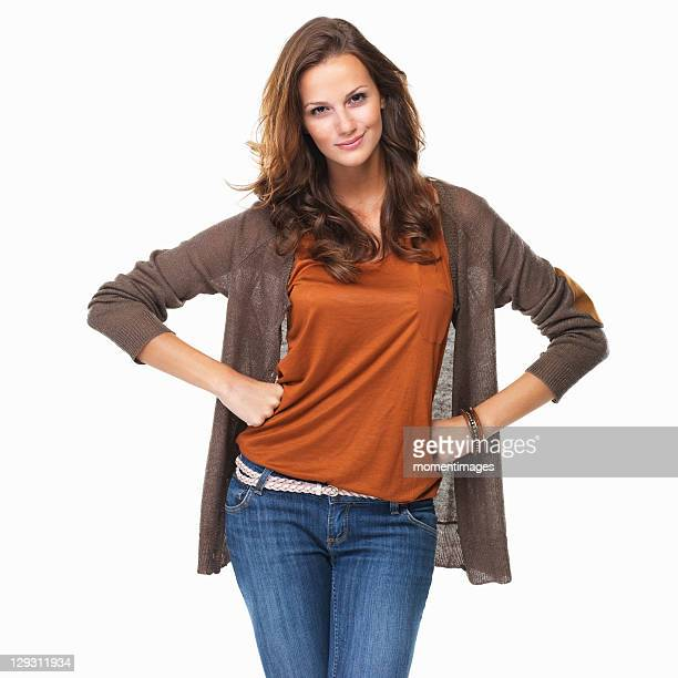 studio shot of young woman with arms akimbo - smirking stock pictures, royalty-free photos & images