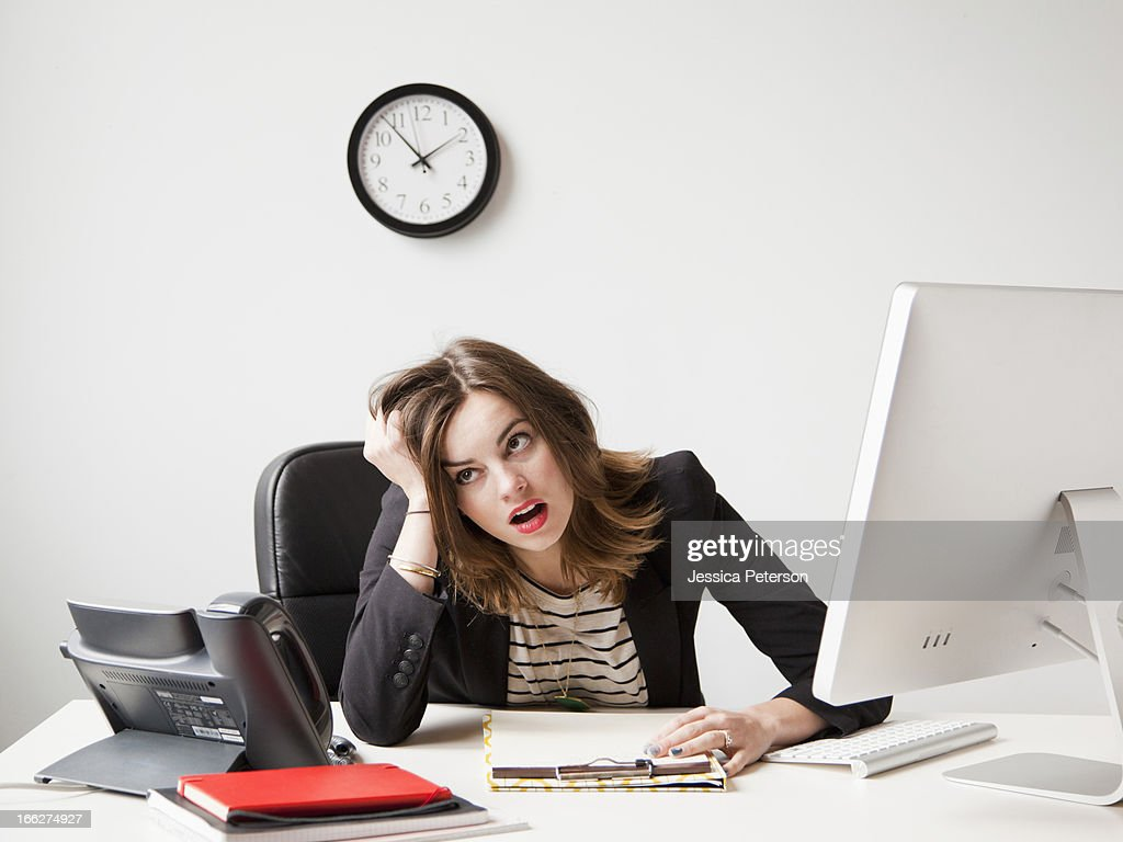 Studio shot of young woman working in office being under emotional stress : Stock Photo