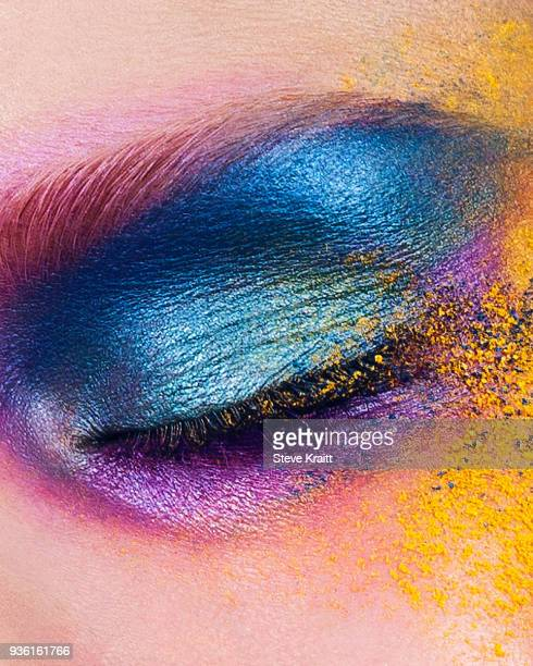 studio shot of young womans eye with multi coloured powder eye shadow, close up - eye make up stock pictures, royalty-free photos & images