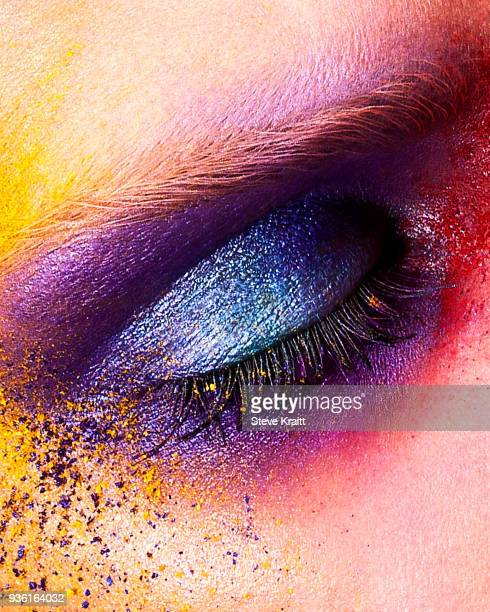 studio shot of young womans eye with multi coloured powder eye shadow, close up - female anatomy stock photos and pictures