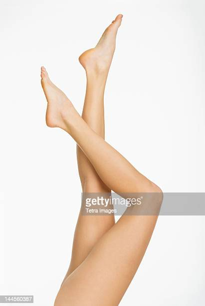 studio shot of young woman's legs - beautiful bare women stock pictures, royalty-free photos & images
