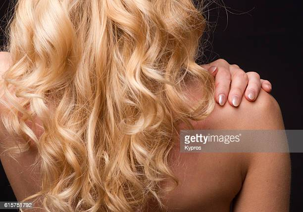 studio shot of young woman's shoulder - czech model stock pictures, royalty-free photos & images