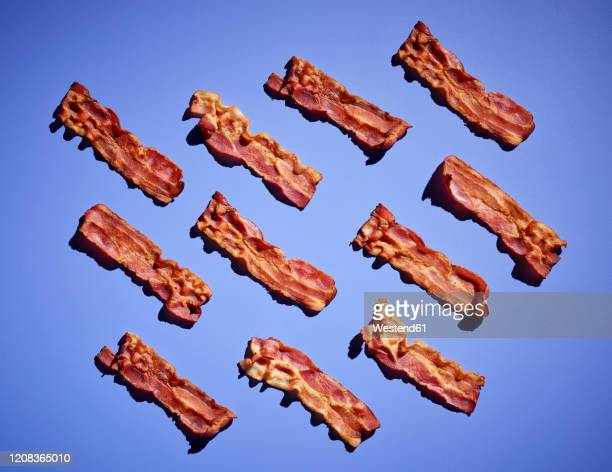 studio shot ofbacon strips against purple background - large group of objects stock pictures, royalty-free photos & images