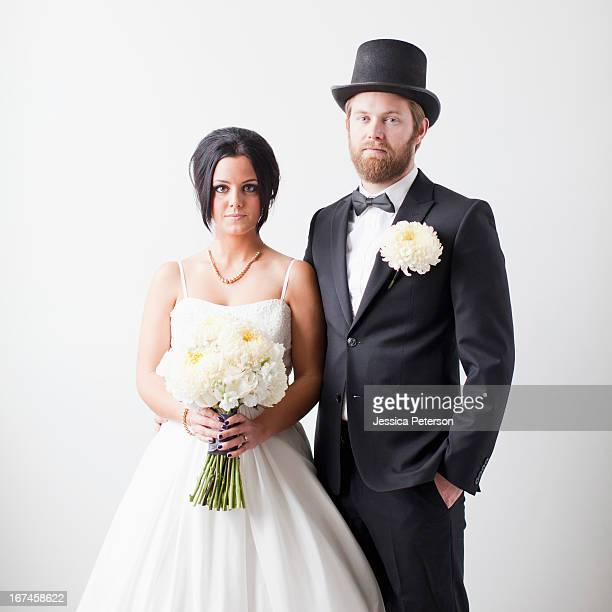 studio shot portrait of bride and groom - top hat stock pictures, royalty-free photos & images