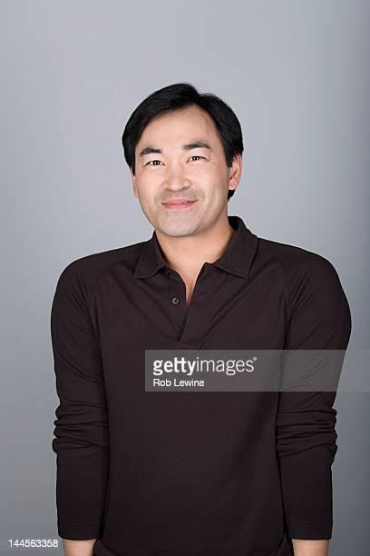 Studio shot portrait of mature man, waist up