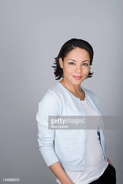 Studio shot portrait of mid adult woman, waist up