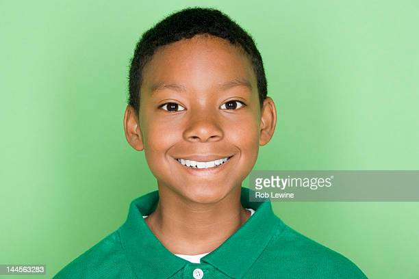 studio shot portrait of young man in polo shirt, head and shoulders - one teenage boy only stock pictures, royalty-free photos & images