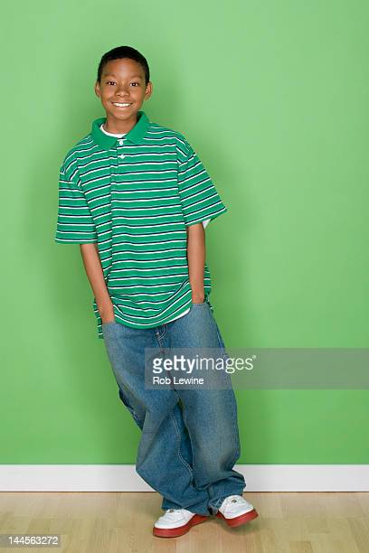 studio shot portrait of young man with hands in pocket, full length - one teenage boy only stock pictures, royalty-free photos & images