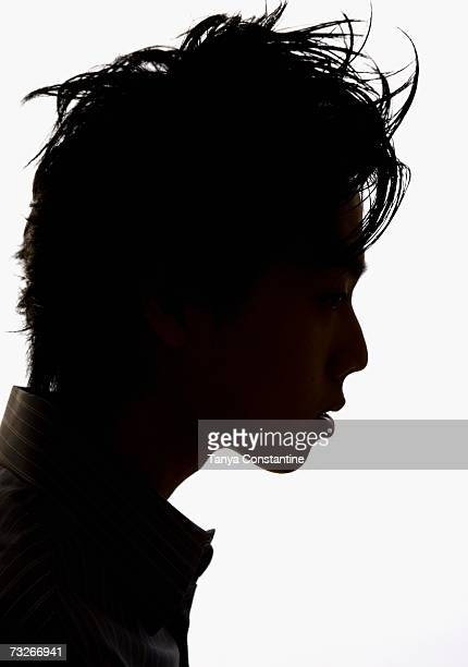 Studio shot profile silhouette of young man